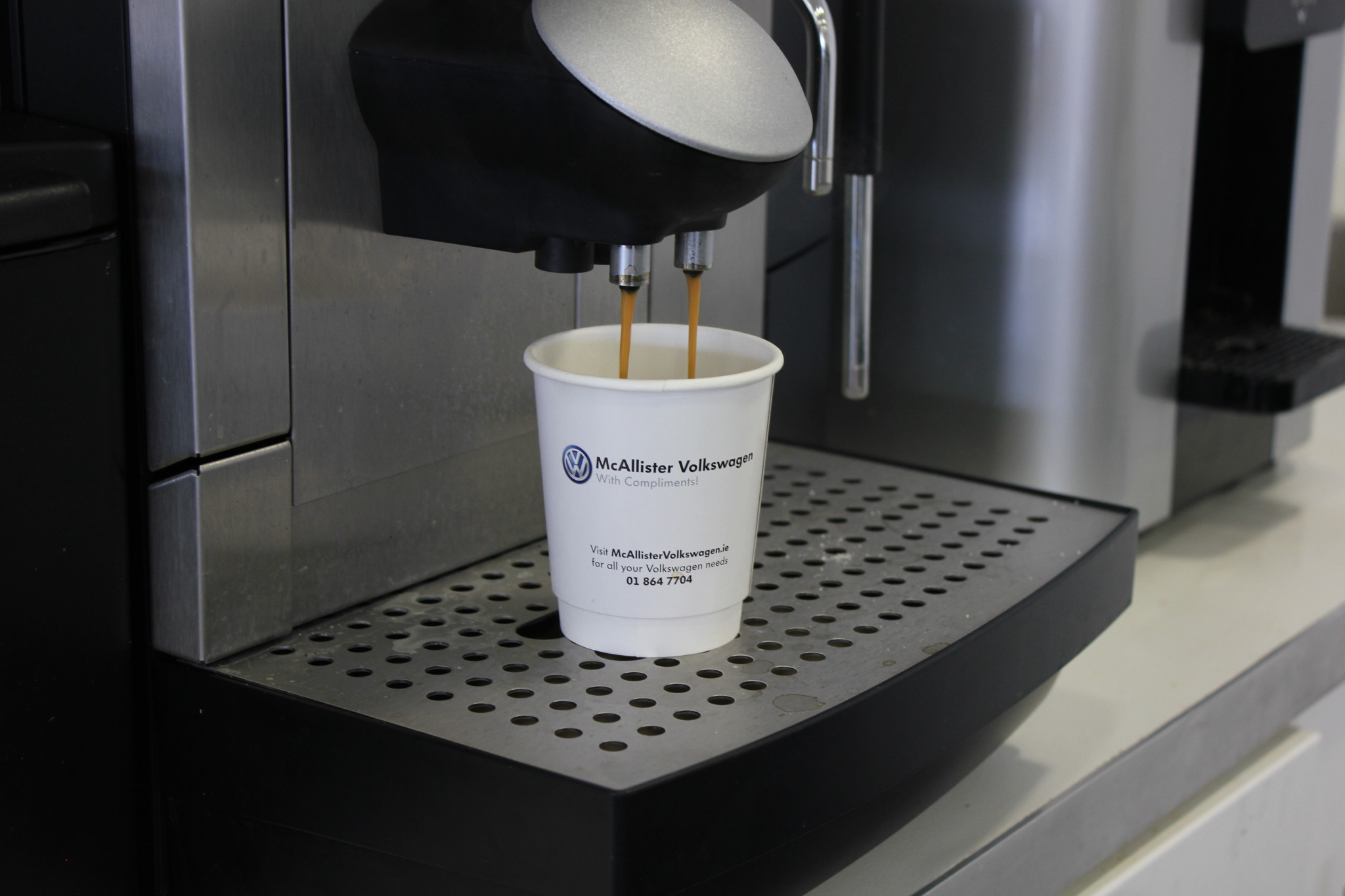 The-Paper-Cup-Factory-branded-paper-cup-being-used-at-a-local-car-dealership-coffee-machine Branded Paper Cups